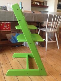 Green Stokke, Tripp Trapp chair, adjustable positioning of seat and footplate with Allen key.