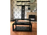Extendable glass TV stand