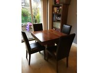 Dining Table and Chairs. Solid dark Mango Wood table and leather chairs.