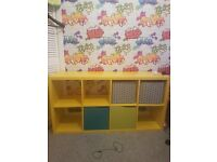 Yellow storage /tv/games unit with some doors and drawers