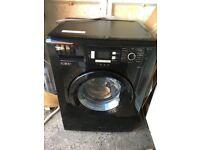 Beko 7 Kg Washine machine in black.