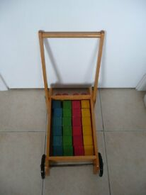 CHILDS TROLLEY AND WOODEN BRICKS