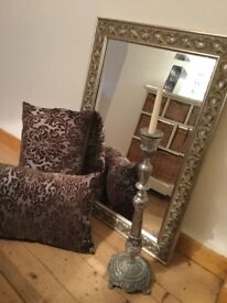 Mirror, cushions,candlestick combo. silver toned col scheme.