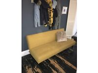 Beautiful mustard sofa bed from MADE