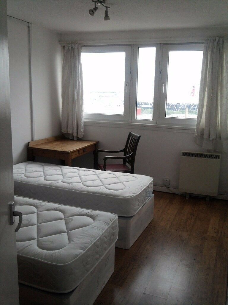 Twin room in Bow, Comfortable flat with Amazing Olympic and Canary Wharf views!