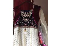 Lovely dress with trail. brand new with tags