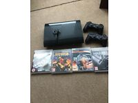 Sony PS3 + 2 controllers + ear piece + 4 games