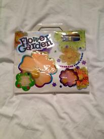 MAKE YOUR OWN FLOWERS WITH FLOWER GARDEN CRAFT KIT. NEW IN PACKET.