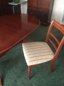 Oval dining room table and 3 chairs