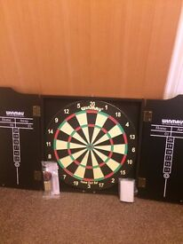Winmau dartboard and cabinet - like new