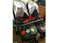 Obaby- Disney Mickey double strollers complete with footmuffs change bag & raincover