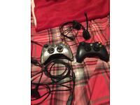 2 controllers, charging cable and headset