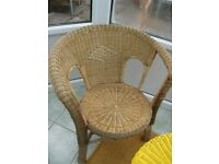 Conservatory/patio quality wicker chairs with design on it in green and red