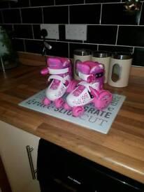 Girls pink Rollerskates