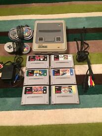 SNES + 6 games, 2 controllers, official leads.