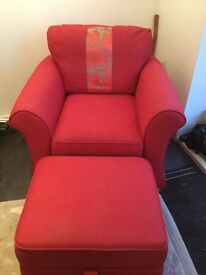 Lovely red armchair with foot stall storage!