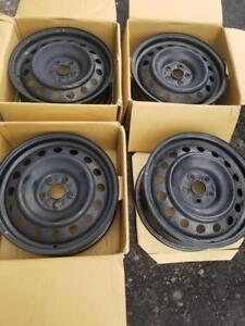 BRAND NEW TAKE OFF SCION FACTORY OEM 16 INCH  ( 5 X 100 ) STEEL WHEEL  SET OF FOUR.