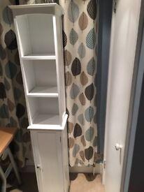Tall white wooden storage cupboard