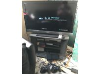 Playstation 2 Slimline console with games bundle, 3 controllers and steering wheel £70