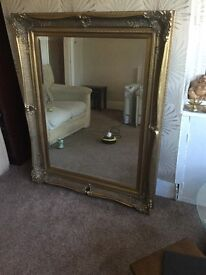 Huge ornate gold framed mirror