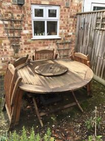 Garden table, 4 chairs, cushions and parasol