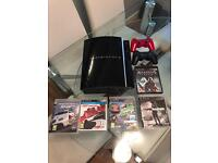 PlayStation 3, 5 games and 2 pads