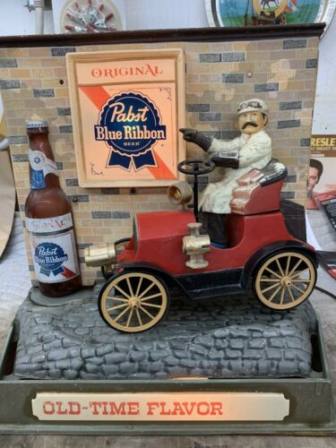 Pabst Blue Ribbon Display. Old Open Car Wheels Move Bumpy Ride