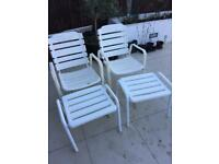 2 metal patio chairs with footstools