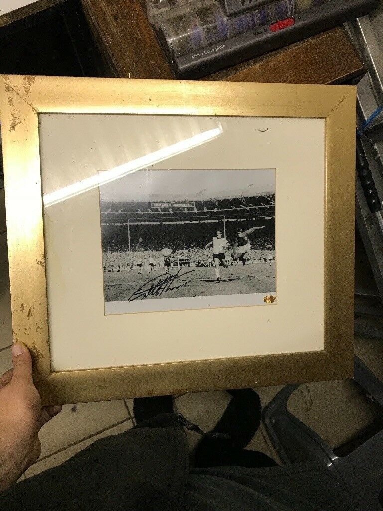 Geoff Hurst signed picture from 1966 World Cup. Certificate of authenticity attached.