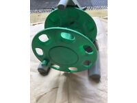Hozelock storage reel and a watering can