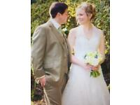 Full dry cleaned size 12 wedding dress by Sophia Tolli
