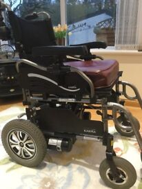 Powered wheelchair carer control or user control