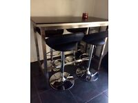 Modern free standing dining/ bar table with 4 black and silver leather look height adjustable stools