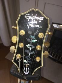 Epiphone by Gibson Sheraton 335 with Gibson 57 pickups, Grover tuners. 1988. Excellent condition.