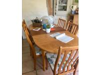 Extending teak dining table and chairs