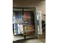 VHS video player and 20 Disney videos plus 5 others in good condition