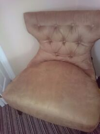 Button back suede chair