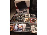 PS3 Slim 120GB Boxed with 9 Games and 2 Controllers