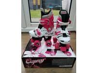 Girls pink and white Osprey quad skates