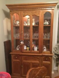 Extending table six chairs and wall unit with lights . Excellent condition.