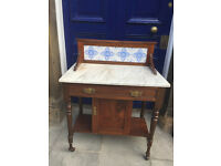 A marble topped ledgeback wash stand .....must be seen.