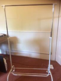 Adjustable clothes rail on wheels