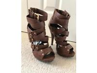 Brown Strappy Stiletto Heel Sandal with metal stud detail. Size 36