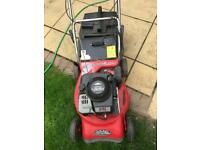 Petrol self propelling lawn mower