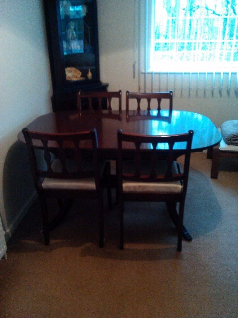 Vintage dark solid wood table & 6 chairs