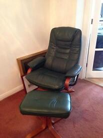 Green leather swivel chair and footstool.