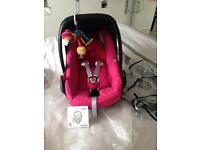 Maxi cosi berry pink pebble car seat. Raincover Lamaze toy .£50