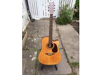 Vintage electro acoustic 6 string guitar with case