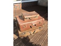 Stack of 3 vintage leather suitcases