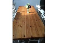 Solid farmhouse oak dining table and 6 white chairs